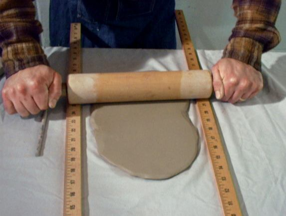 rolling a slab of clay