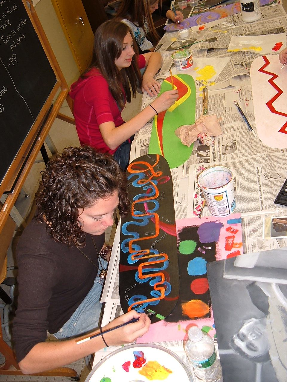 Art lesson designing skateboard deck graphics for Kids painting class