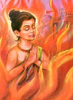 Prahlad praying while in the fire