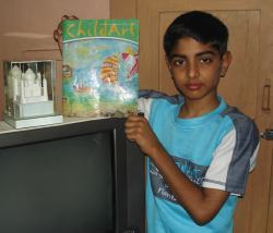Gaurav shows off a book he illustrated