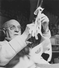 Matisse cutting paper in his bed